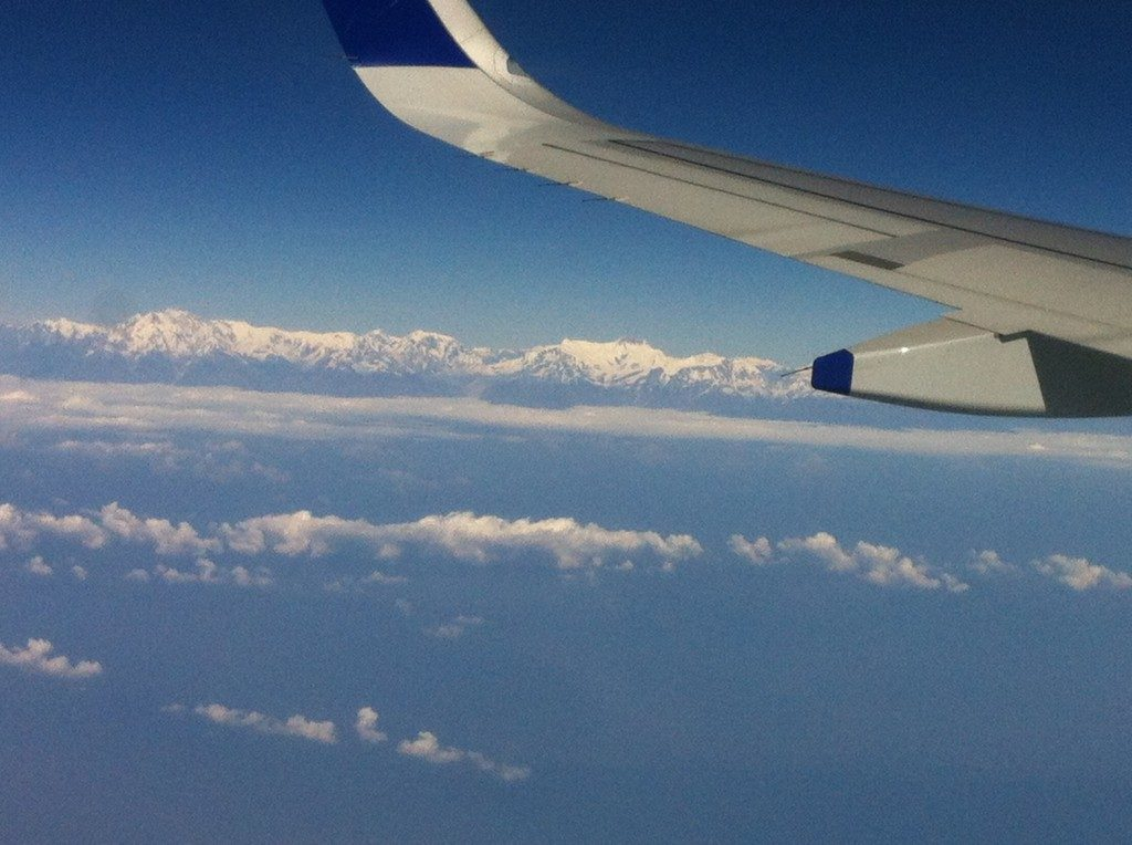 Himalayas seen while circling Kathmandu's Tribhuvan International Airport. For some reason we were not cleared to land and went around in circles for some time, giving us a great view of the mountains.